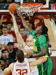 Oregon's Chris Boucher, right, blocks a shot by Southern California's Strahinja Gavrilovic, left, while Southern Cal's Nikola Jovanovic, bottom, looks on during the first half of an NCAA college basketball game, Saturday, March 5, 2016, in Los Angeles.