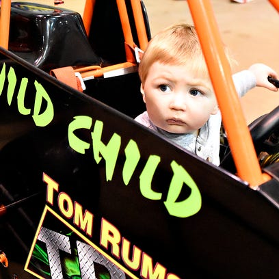 Levi Smith, 1, of New Oxford, looks out from a race
