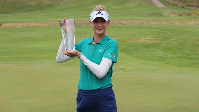Nelly Korda poses with the trophy after she won the Sioux Falls GreatLIFE Challenge.