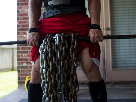 Alan Krockover trains on his back porch on Thursday, July 5, 2018, as he prepares for the US in international Powerlifting Federations Masters World competition in Mongolia in October.