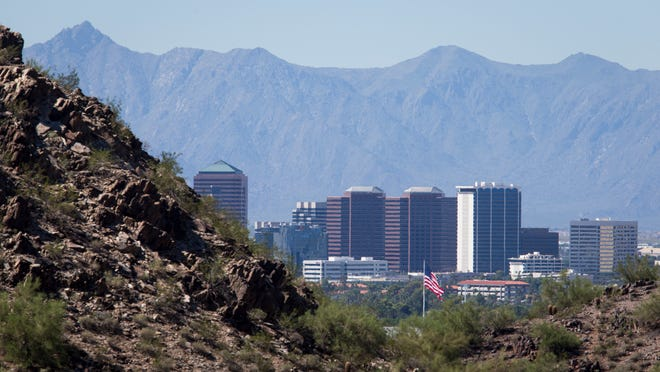 The Phoenix skyline is clear from Piestewa Peak, looking south toward South Mountain, Monday morning, Sept. 14, 2014.
