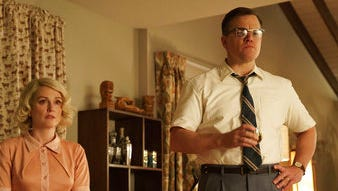 "Julianne Moore, left, and Matt Damon in a scene from ""Suburbicon."""