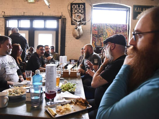 The Old Dog Whisker Club meets during its first meeting of the year at the Old Dog Tavern in Kalamazoo. The members grow their beards and mustaches for national competitions.