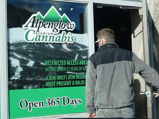 A customer enters the Alpenglow Botanicals cannabis