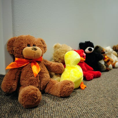 Teddy bears line the hallway that children get to take