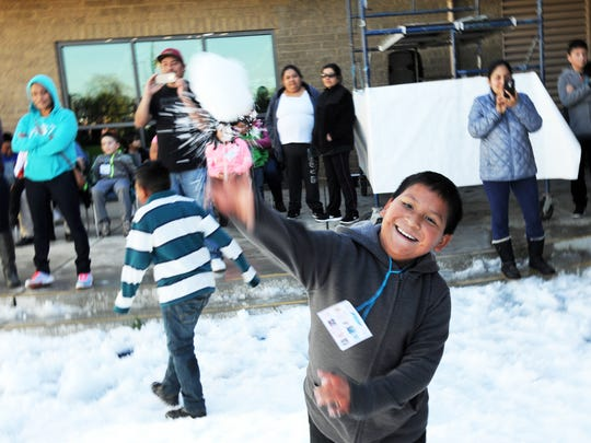 Enjoying the César Chávez Library's fourth annual Snow Day in east Salinas.
