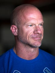 Anthony DiSarro, owner of Crossfit Redline, poses for