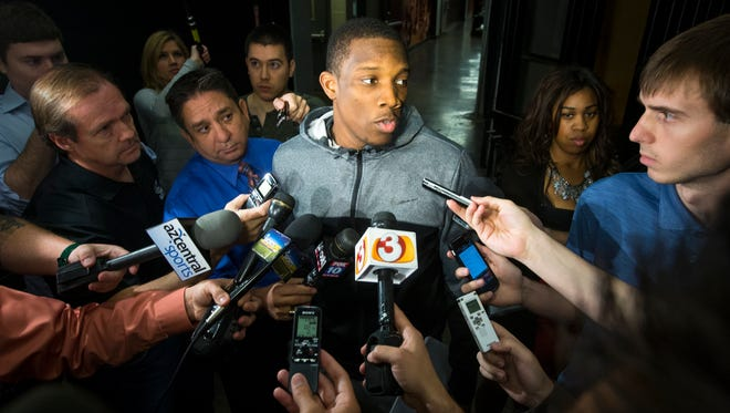 Phoenix Suns' point guard Eric Bledsoe talks with the media after he cleared out his US Airways Center locker at the end of the season on Thursday, April 17, 2014.