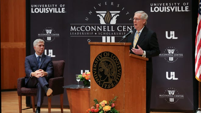 Senator Mitch McConnell, right, introduced Supreme Court Associate Justice Neil Gorsuch just before he made remarks during the McConnell Center's Distinguished Speakers Series at the University of Louisville.  