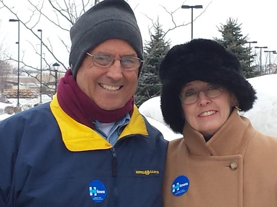 Rob and Claudia Host, who moved to West Des Moines from Hawaii, bundled up earlier this month to knock on voters' doors on Hillary Clinton's behalf.