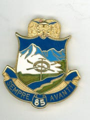 The 10th Mountain Division consisted of three regiments – 85th, 86th and 87th. The 85th regimental pin has a ram's head on top with skis and ice axe over a background of mountains.