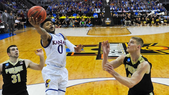 Frank Mason (left) and the Jayhawks are rolling into the Elite Eight.