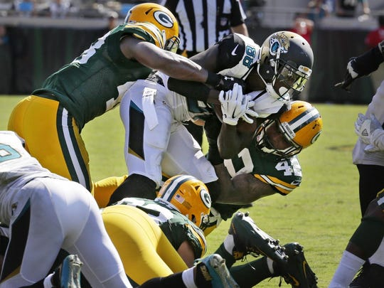 Jaguars wide receiver Allen Hurns is taken down by Packers defenders to seal a Week 1 victory.