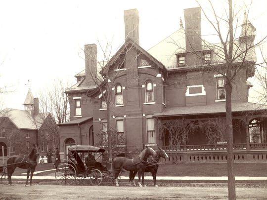 The side of the Crary Mansion showing the carriage house, which still stands, around 1890.