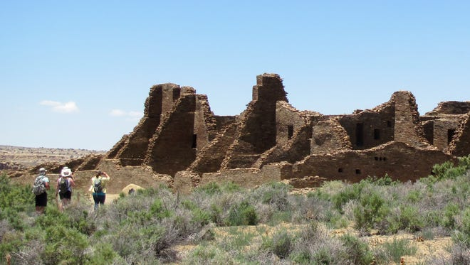Visitors walk to an ancestral Puebloan ruin June 2013 at Chaco Culture National Historic Park.