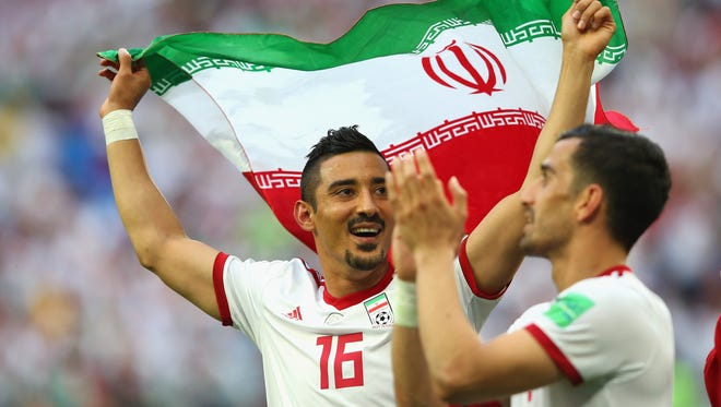 Iran's Reza Ghoochannejhad of Iran celebrates after the win against Morocco.