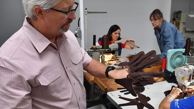 Rob Storey, executive vice president of Nokona American Ballgloves, shows how the inside liner part of the baseball glove is assembled. The leathergoods company has been in business in Nocona, Texas since 1926.