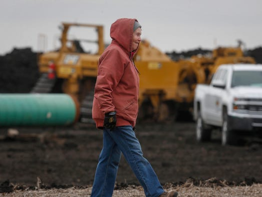 Shirley Gerjets walks near the construction site of