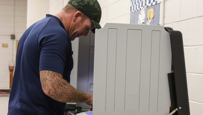 Jim Heisinger casts his vote at Norman Smith Elementary School on Election Day.