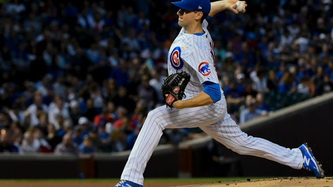 Chicago Cubs starting pitcher Kyle Hendricks (28) delivers during the first inning of a baseball game against the Milwaukee Brewers on Wednesday, Sept. 12, 2018, in Chicago. (AP Photo/Matt Marton)