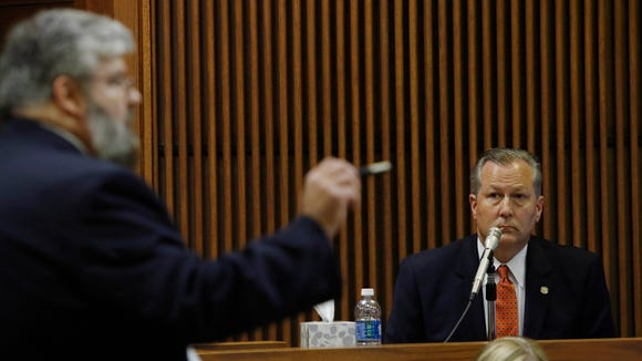 Alabama House Speaker Mike Hubbard answers questions from Deputy Attorney General Matt Hart during his trial, Thursday, June 9, 2016, in Opelika, Ala. Hubbard faces 23 felony ethics charges accusing him of using his political positions to make money and seek financial favors, investments and employment from lobbyists and people with business before the Alabama Legislature. (Todd J. Van Emst/Opelika-Auburn News via AP, Pool)