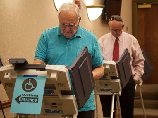 Residents of Washington City vote at the Washington City Hall Tuesday, Nov. 3, 2015.