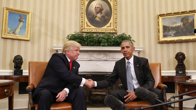 President Barack Obama and President-elect Donald Trump shake hands after their meeting in the Oval Office of the White House in Washington, D.C., on Thursday.