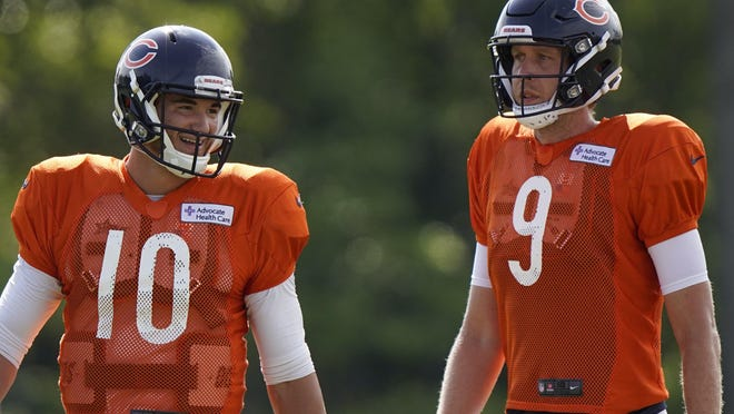 Chicago Bears quarterbacks Mitchell Trubisky, left, and Nick Foles walk on the field during training camp in August. Coach Matt Nagy named Tribusky as the starter leaving the newly-signed Westlake grad as the team's back-up heading into the season.