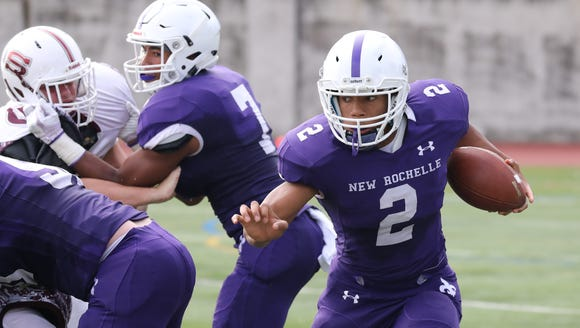 New Rochelle's Romeo Holden gains some yards against