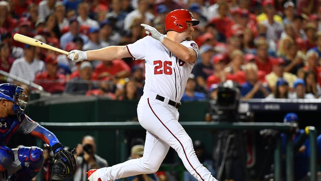 Washington Nationals pinch hitter Adam Lind hits a single during the eighth inning in game two of the 2017 NLDS against the Chicago Cubs on Oct 7, 2017 at Nationals Park.