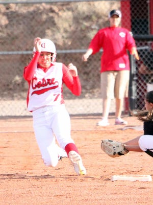 Cobre shortstop Danni Misquez made the All-South squad. She is seen sliding into second base. She batted .477 with 31 RBIs, 14 doubles, two triples and two homers.