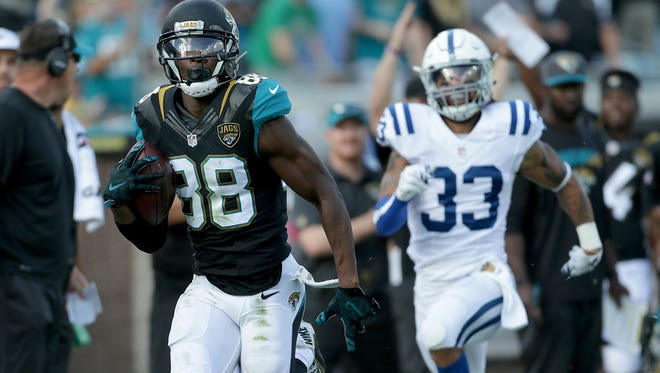 Jacksonville Jaguars wide receiver Allen Hurns (88) runs by Indianapolis Colts free safety Dwight Lowery (33) for a touchdown in the third quarter of their game at EverBank Field Sunday, December 13, 2015, afternoon  in Jacksonville FL.