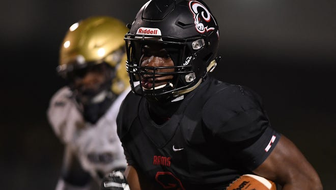 Hillcrest's Donte Anthony (2) breaks away to score against Spartanburg during the Rams' 33-14 win in the second round of the Class AAAAA playoffs Friday night at Chandler Stadium.