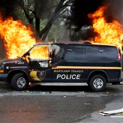 A police vehicle burns, Monday during unrest following