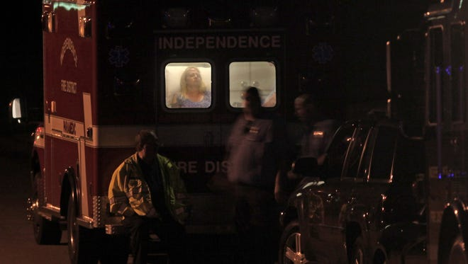 Audree Sullivan is treated in an ambulance after she was held hostage in Independence for several hours Monday night.