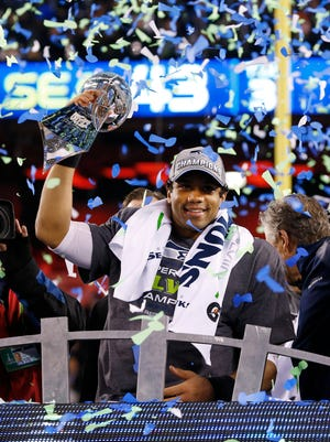 Seattle Seahawks quarterback Russell Wilson celebrates his Super Bowl victory a year ago. On Sunday, he looks to make it two in a row.