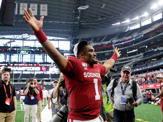 Dec 7, 2019; Arlington, TX, USA; Oklahoma Sooners quarterback Jalen Hurts (1) celebrates with fans after the game against the Baylor Bears in the 2019 Big 12 Championship Game at AT&T Stadium. Mandatory Credit: Kevin Jairaj-USA TODAY Sports