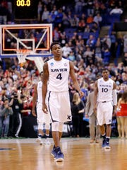 Xavier's Edmond Sumner, left, and Remy Abell walk toward