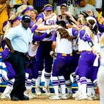 The LSU softball team mobs Bailey Landry after her