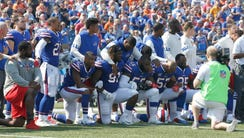 Buffalo Bills players kneel in protest during the National