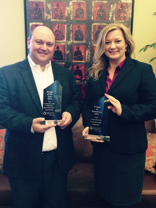 Jason Leffel and Amy with awards.jpg