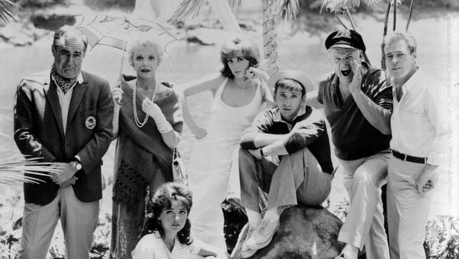 From left: Jim Backus, Natalie Schafer, Dawn Wells (sitting), Tina Louise, Bob Denver, Alan Hale, Jr., and Russell Johnson in a scene from the 1960's television show, 'Gilligan's Island.'