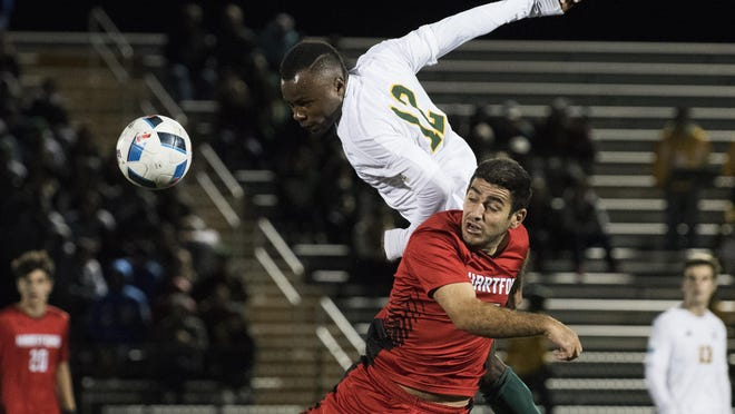 Vermont's Mikel Kabala (12) leaps to head the ball during the men's soccer game between the Hartford Hawks and the Vermont Catamounts at Virtue Field on Saturday night Octover 15, 2016 in Burlington. (BRIAN JENKINS/for the FREE PRESS)
