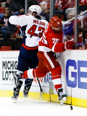 Washington Capitals right wing Tom Wilson, a former Plymouth Whaler, checks Detroit Red Wings defenseman Mike Green (25) in the second period at Joe Louis Arena.