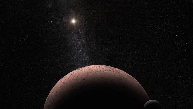 An artist's interpretation of the small moon MK 2 orbiting the dwarf planet Makemake.