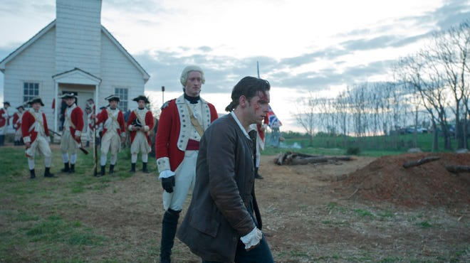 Colonist Abraham Woodhull (Jamie Bell, right) is drawn into a spy ring that's based on the real-life Culper Ring in 'Turn.' His job is to provide information on the movements of the British, led by Capt. Simcoe (Samuel Roukin).