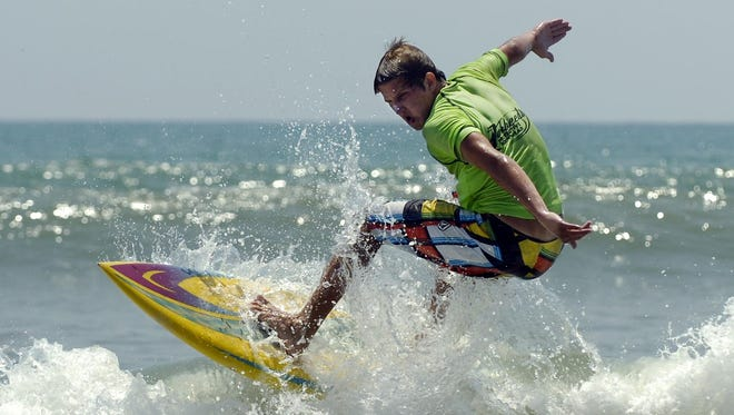 Paul Lahee surfs at a previous Waterman's Challenge.