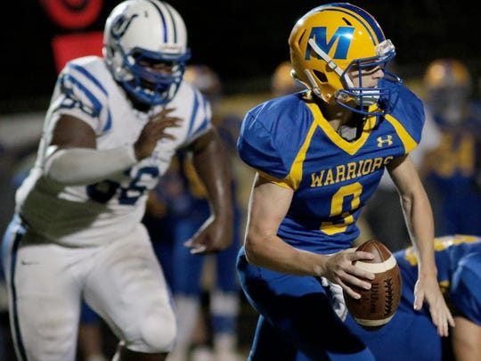 Mariemont's Wally Renie scrambles during the Warriors' football game against Wyoming, Friday, Oct. 20, 2017.