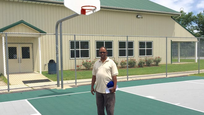 This June 21, 2016 photo shows Princess Anne Town Commissioner Garland Hayward on the basketball court at the Garland Hayward Youth Center and Park in Princess Anne. Starting July 5, schoolchildren around the town can attend the center for an all-day, six-week academic enrichment and recreational program. The summer youth program is in its fifth year.