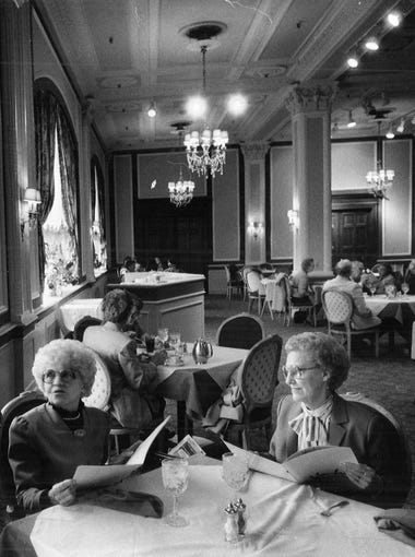 Astrid Benson, left, and Lucille Thornburg visit the Younkers Tearoom in April 1986. The tearoom was opened in 1913 in the downtown Des Moines Younkers building.